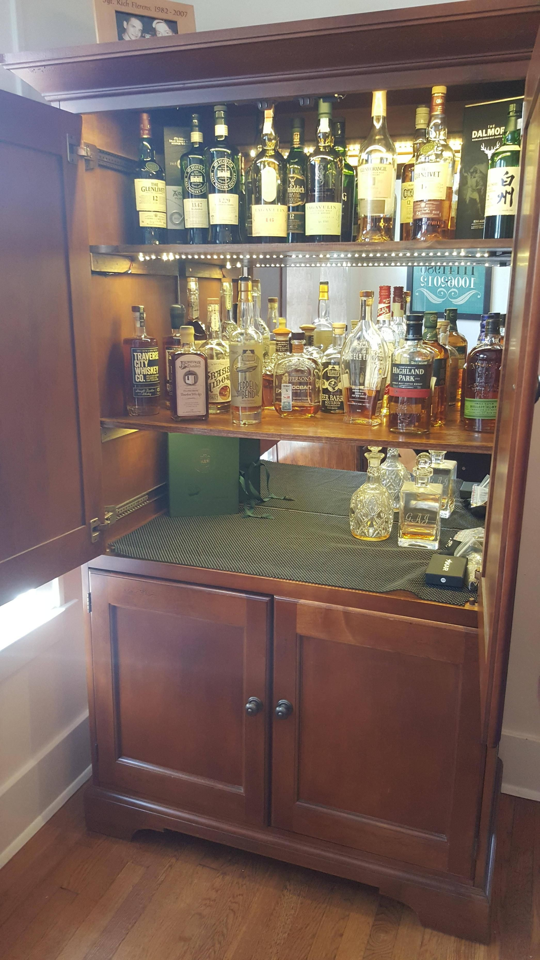 diy converted a tv hutch into a lit up liquor cabinet