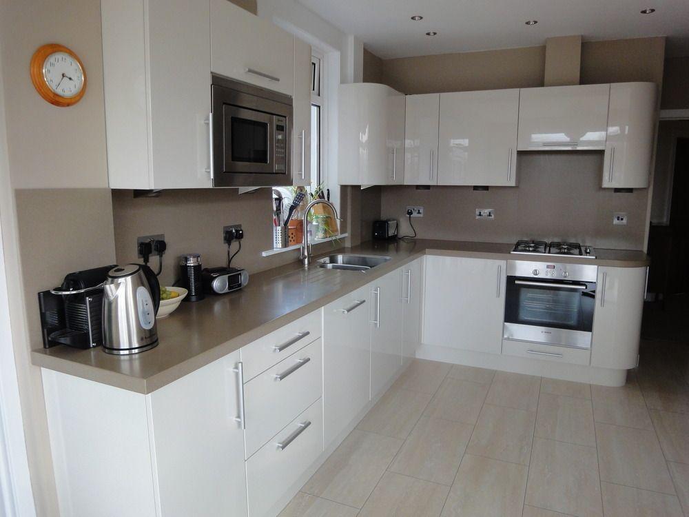 Cream gloss kitchen black worktop google search house for Cream black kitchen designs