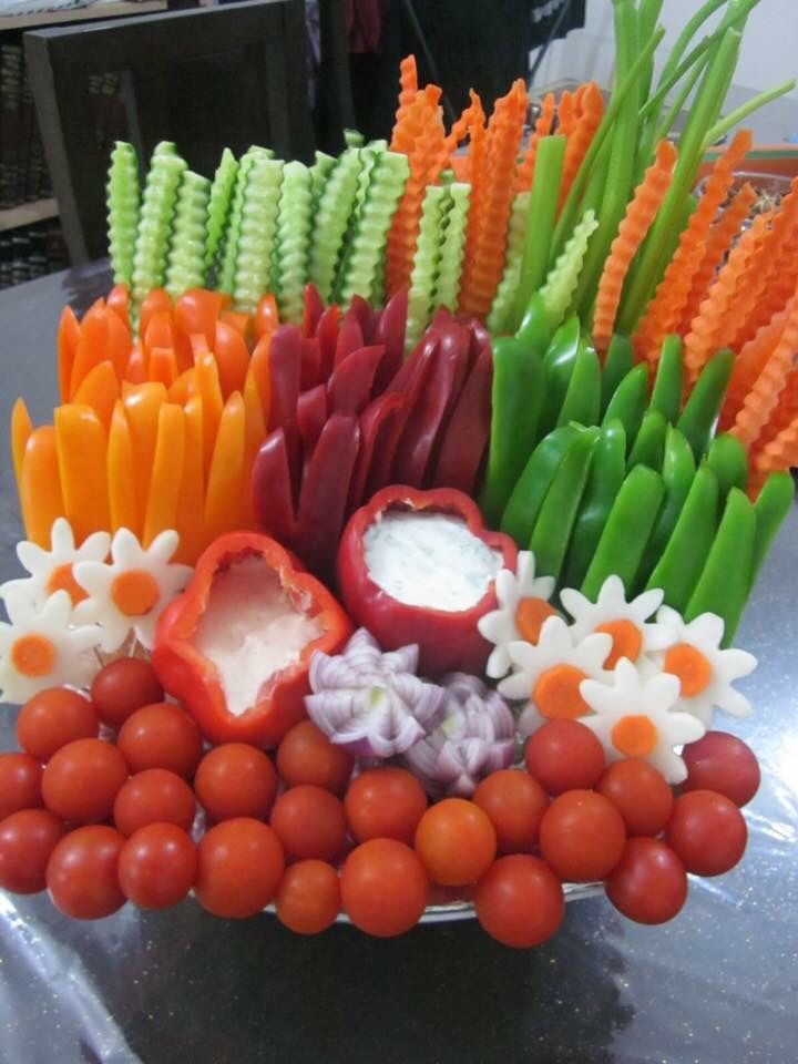 Extravagant veggie trays always make it to the appetizer table- my mom has always made eating veggies a fun experience that keeps us healthy!