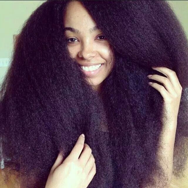 Gorgeous natural hair...proof black hair does grow long!!!!...another reason to stay away from chemicals, wigs and weaves!!!!