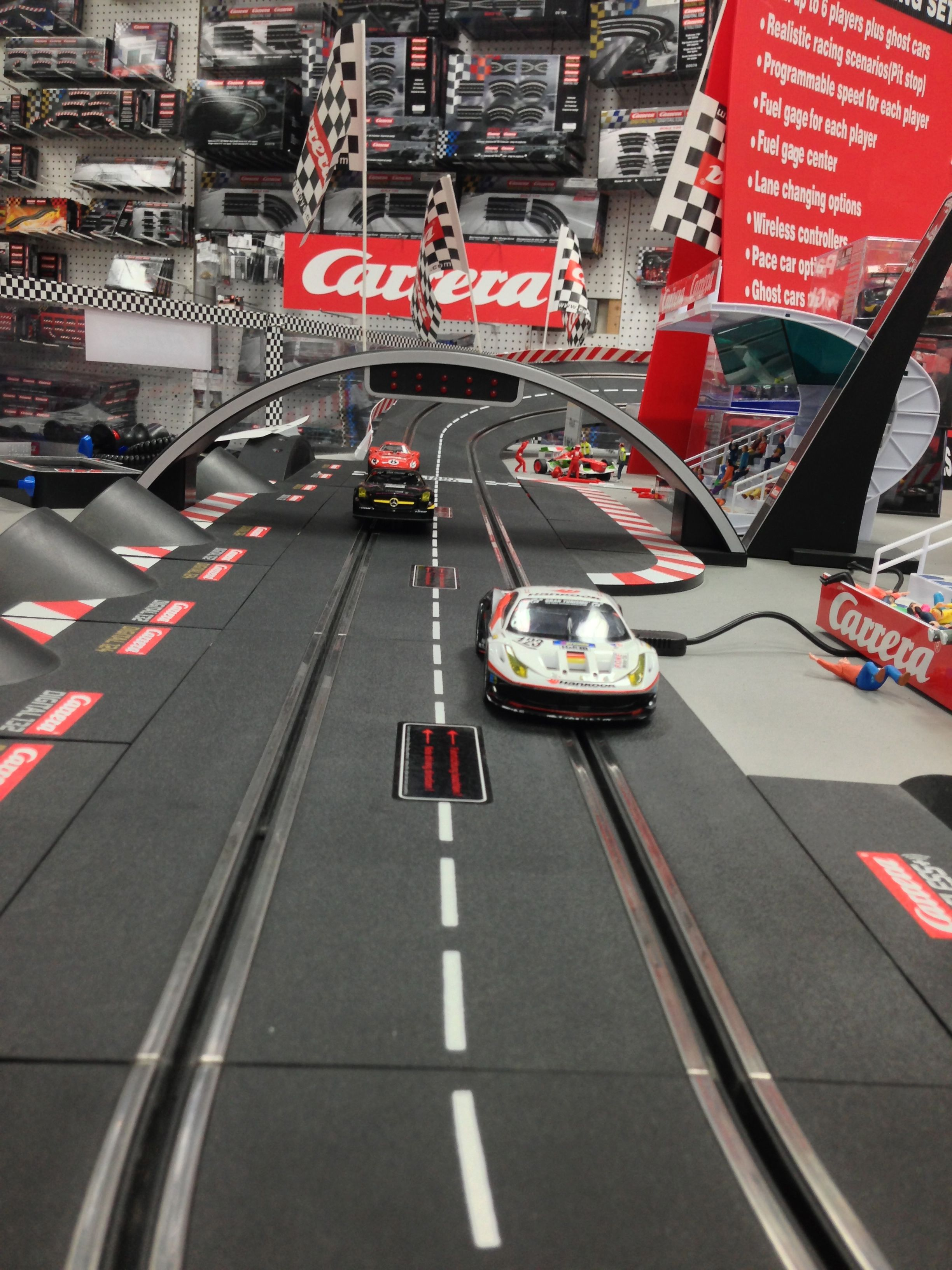carrera slot cars in the store at big boys with cool toys. Black Bedroom Furniture Sets. Home Design Ideas