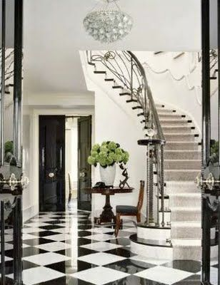 A Black And White Marble Floor In An Entry Stair Hall. This Is A Classic