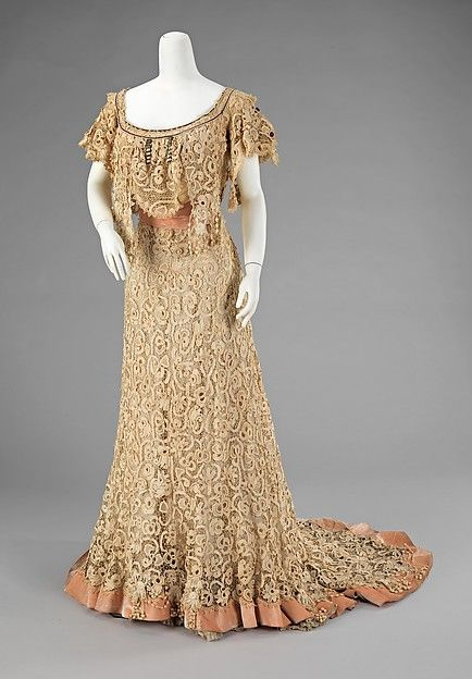 Evening dress Designer: Charles Klein Date: ca. 1910 Culture: French Medium: cotton, silk Dimensions: Length at CB: 72 in. (182.9 cm) Credit Line: Brooklyn Museum Costume Collection at The Metropolitan Museum of Art, Gift of the Brooklyn Museum, 2009; Gift of Mr. and Mrs. Maxime L. Hermanos, 1961