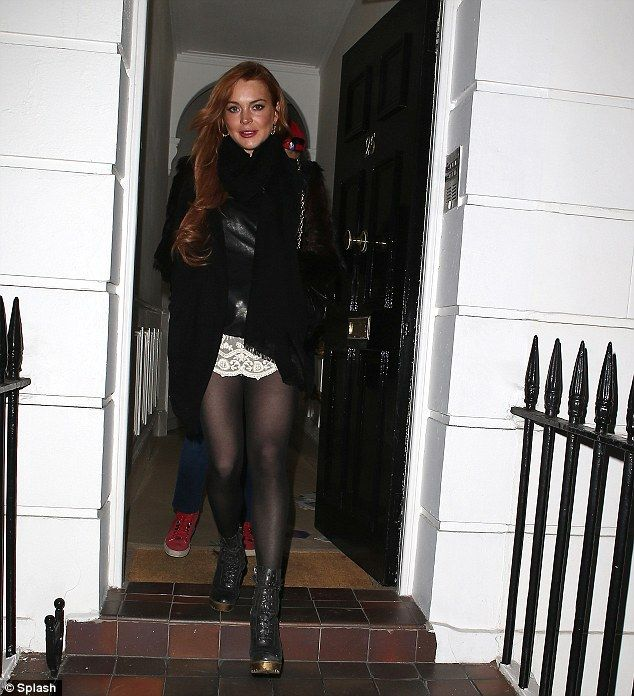 Lindsay Lohan Wears A Leather Jacket And Lace Mini Skirt