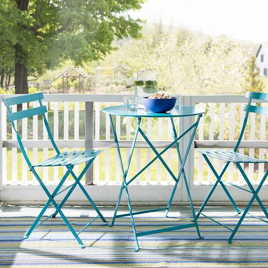 A Turquoise Outdoor Folding Table And Chairs Combination Brings An Ideal Pop Of Color To Your Outdoor Folding Table Outdoor Patio Space Outdoor Furniture Sets