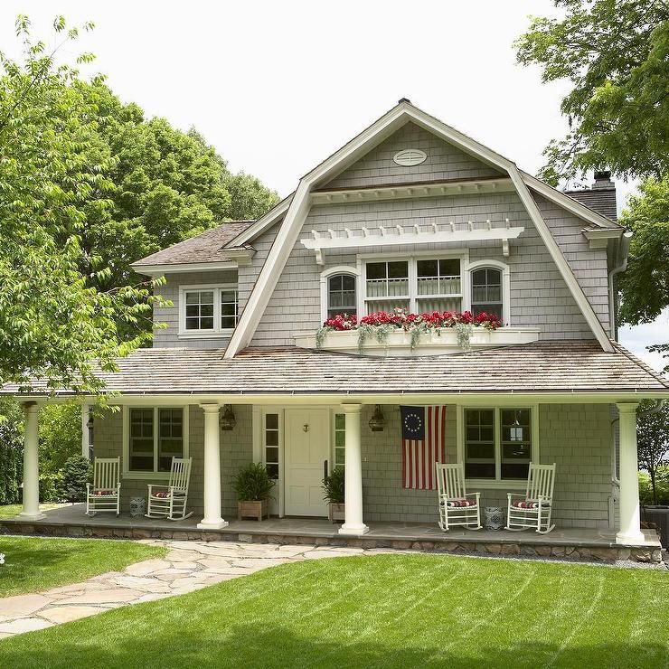Beautiful Traditional 2 Story House In A Dutch Colonial Style Featuring Gray Exterior Siding Dutch Colonial Exterior Colonial Style Homes Dutch Colonial Homes