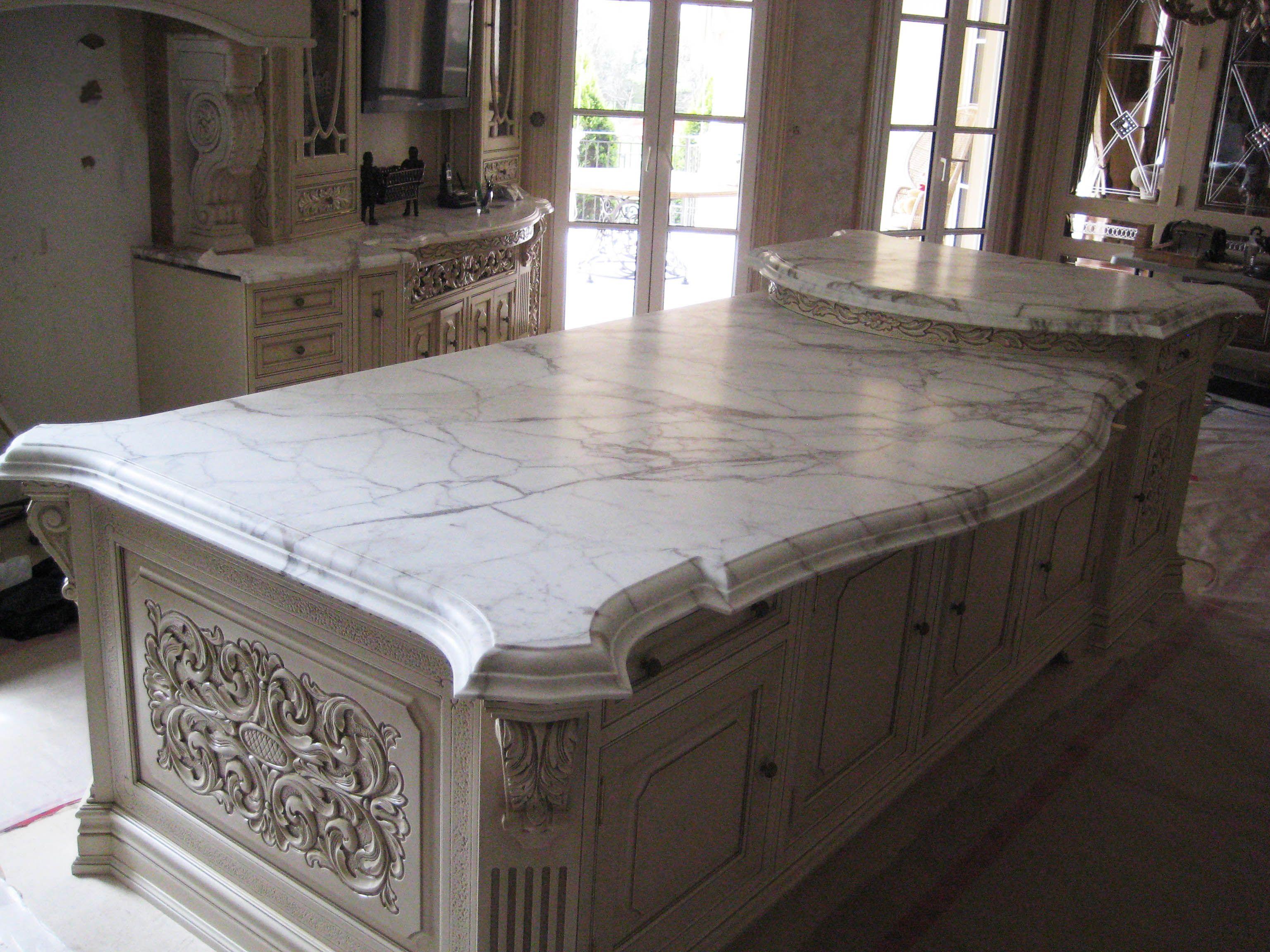 Kitchen island done in Calcutta marble Marble kitchen