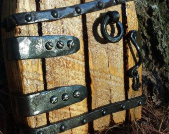 I make these doors from used horse shoes, hand forged hardware, and repurposed items... 5 inches tall and 4 3/4 inches wide. All your wee folk will love them