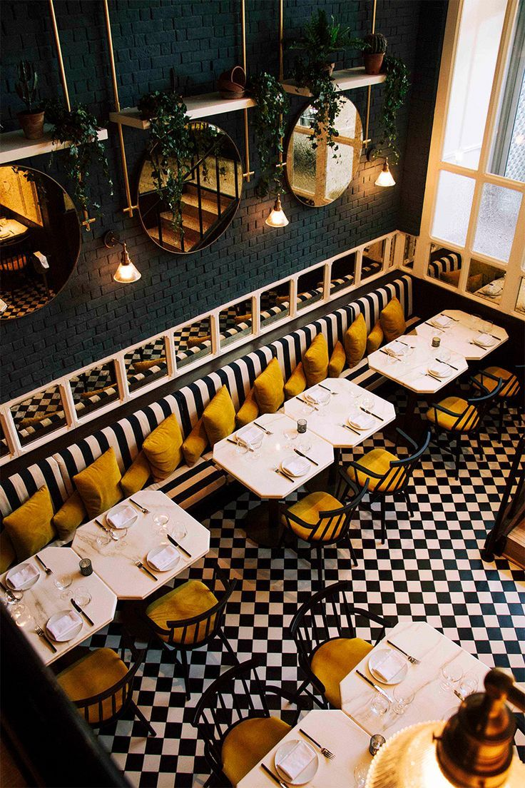 Such A Classic And Fun Color Combo For This Restaurant Black White Mustardyellow Restaurant Layout Restaurant Interior Design Cafe Interior Design