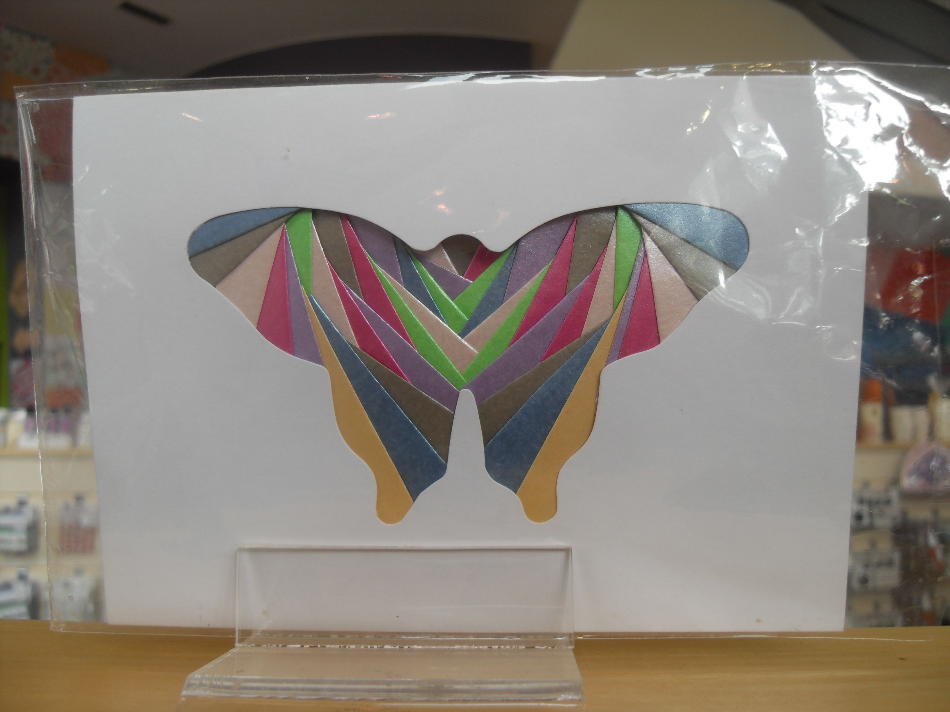 Iris folding.  Folded pieces of coloured paper in an aperture to create an image.