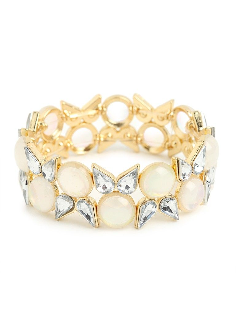 e15cecec6b1 Indulge in the grand extravagance of this stunning statement bracelet.  Featuring both oversized cabochon gems and blooming crystals, the look is  pure polish ...