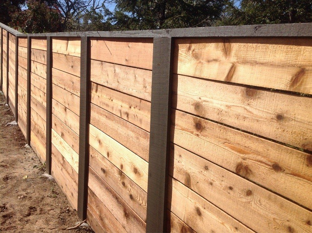 horizontal wooden privacy fences that are two tone brown