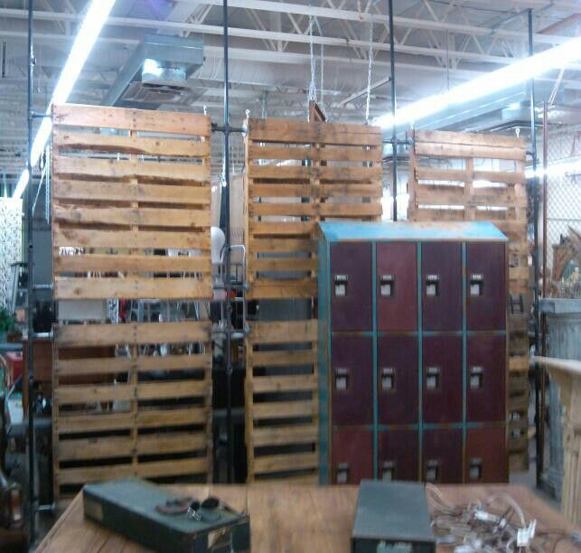 Black pipe and pallet wall Built at Sweet Salvage occasional market Phoenix by R John Diaz