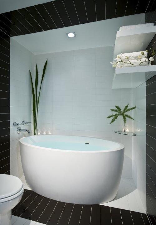 Deep white soaking tub. Stylish bathtub design at The Donovan - A ...
