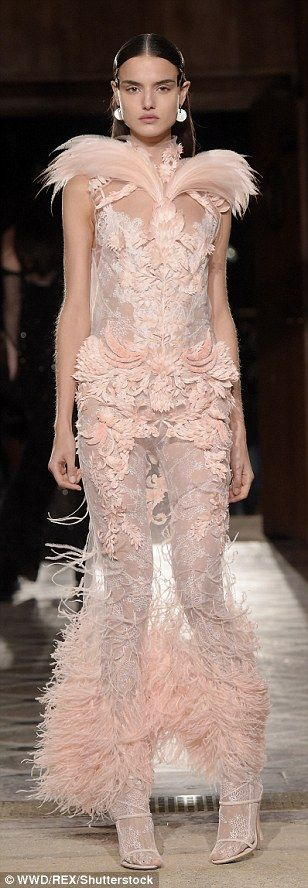 Pretty in pink: Bianca Padilla stood out from the crowd in a feathered, sheer pale pink go...