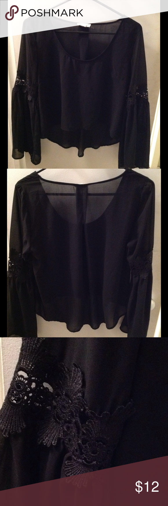 Beautiful Blouse Long sleeved asymmetric blouse with bell sleeves and beautiful appliqués on sleeves. Short in front and longer in back. Tops Blouses