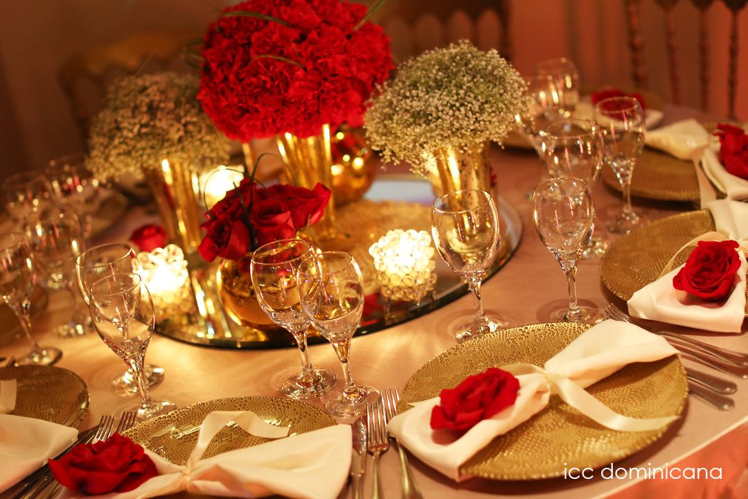 Red wedding centerpieces in roses carnations and baby