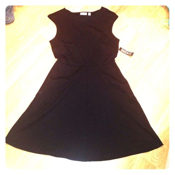 SALENWT fit and flare style black dress New! Black sleeveless dress with front pockets New York & Company Dresses Mini