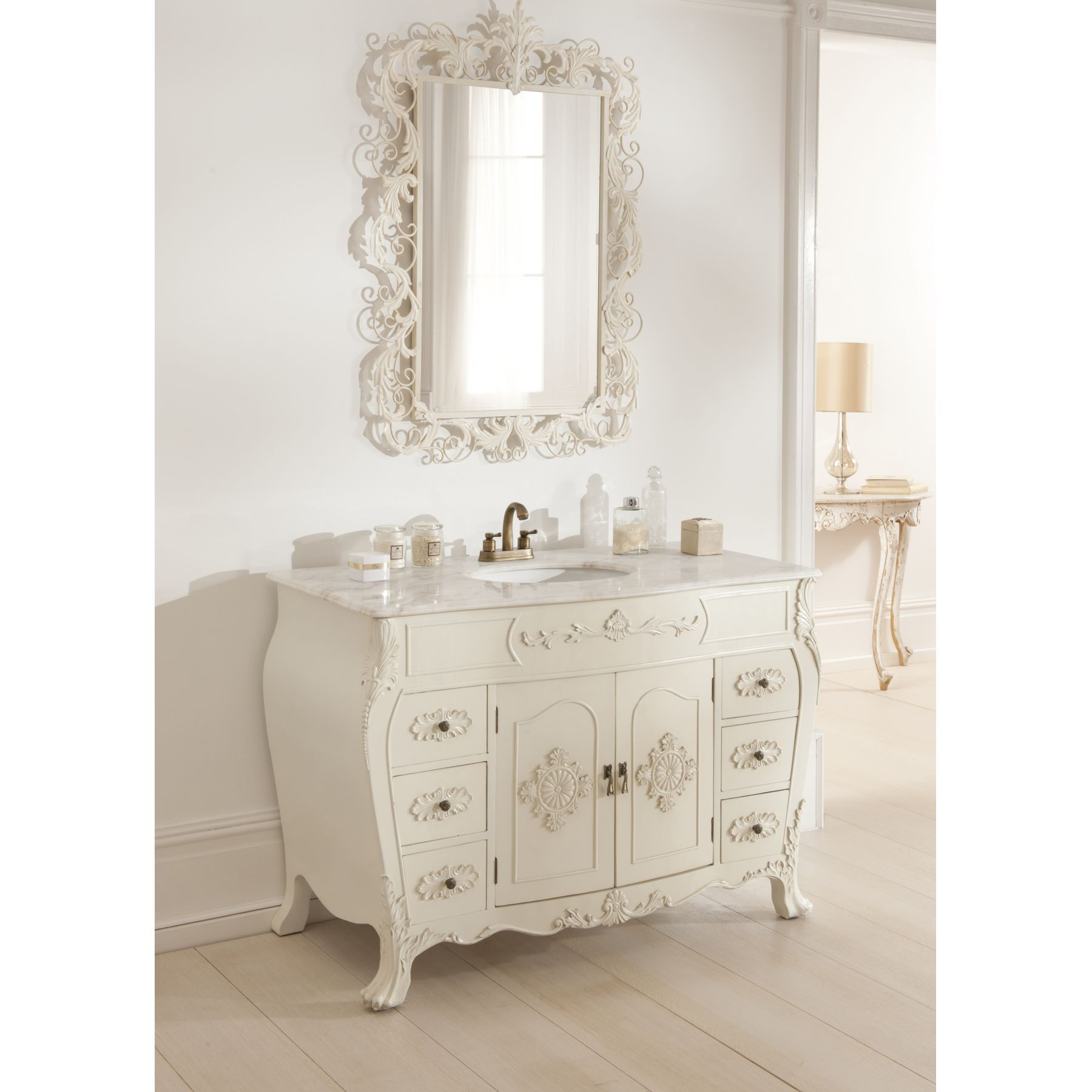 This shabby chic sink with an ornate mirror above creates an