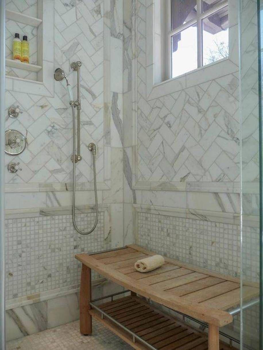 Bathroom Elegant Teak Shower Bench Features Calcutta Gold Marble Herringbone Tiles And Niche