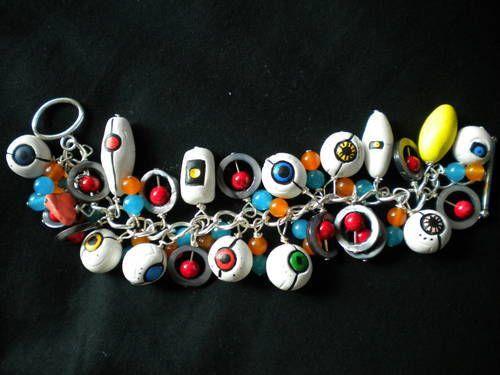 Portal themed cluster bracelet: GLaDOS, P-Body, Atlas, cores, Wheatley, lemon...