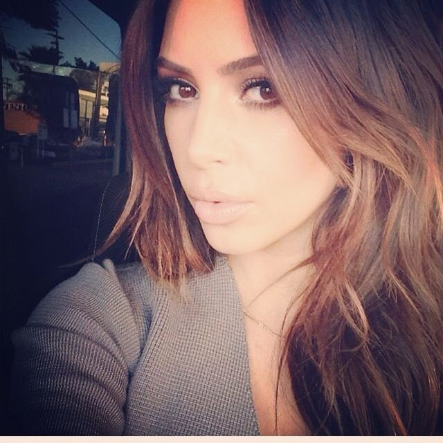 Kim kardashian rocking redken's  splashlights highlights! She looks stunning