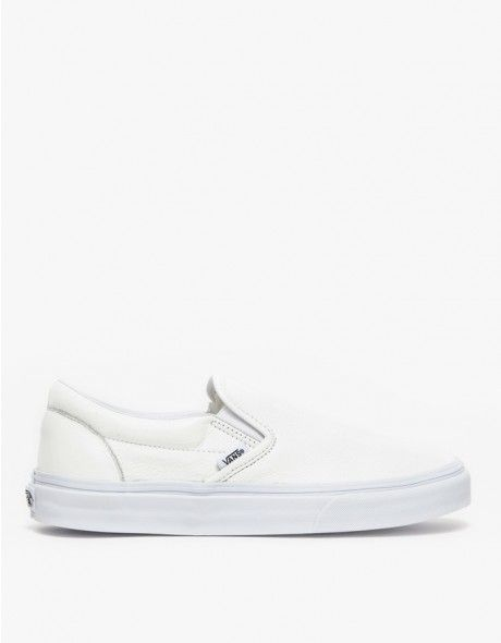 Classic slip-ons in white leather from Vans. Features low top construction, cushioned heel liner, and a rubber waffle sole.  •White leather slip-on •Low top construction •Cushioned heel liner •Rubber waffle outsole •Women's sizes listed
