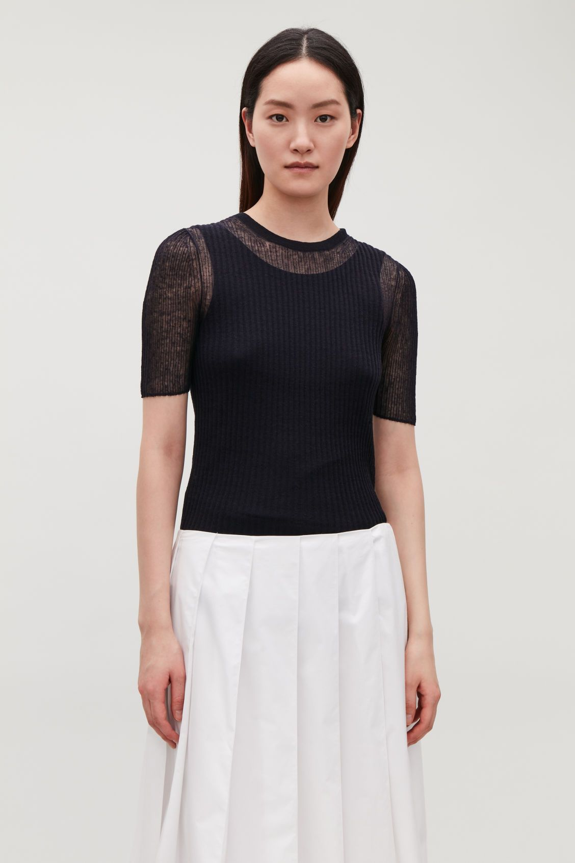 model side image of cos sheer linen ribbed top in blue ref