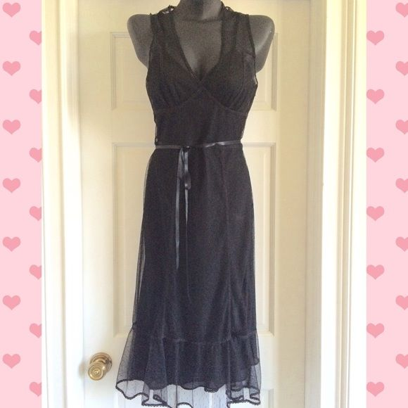 Just InExpress Black Dress Size 5/6 Beautiful Allover Lace dress with slip attached.  It has a belt that ties in the middle or side.  Midi length.  Size 5/6 100% Polyester. Express Dresses Midi