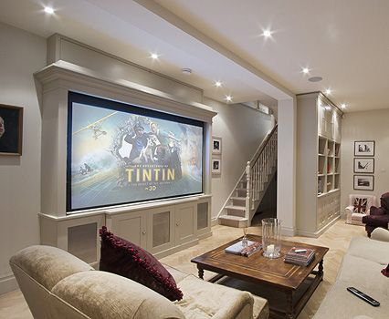 Framed projection screen and love the shelves below screen home