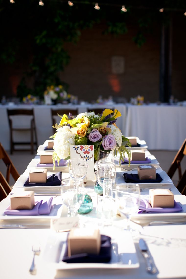 this table setting is lovely with purple hues and touches of citrus. it's understated and approachable and done well.  www.trixandtrumpet.com