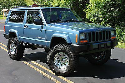Jeep Cherokee Clean 2 Door Blue Lifted Xj New 33 Tires 4x4 1999 Jeep Cherokee Jeep Cherokee Jeep Cherokee Sport