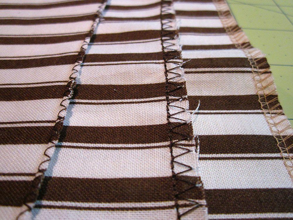 Zig Zag Or Overcast Stitch Edge Of Fabric To Lessen