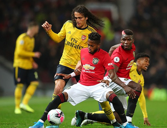 Arsenal holds Manchester United to 11 Draw at Old