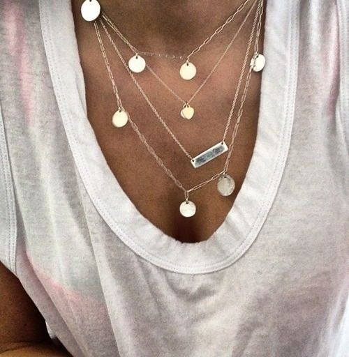 Light jewelry. Coin necklace and thin gold bar.