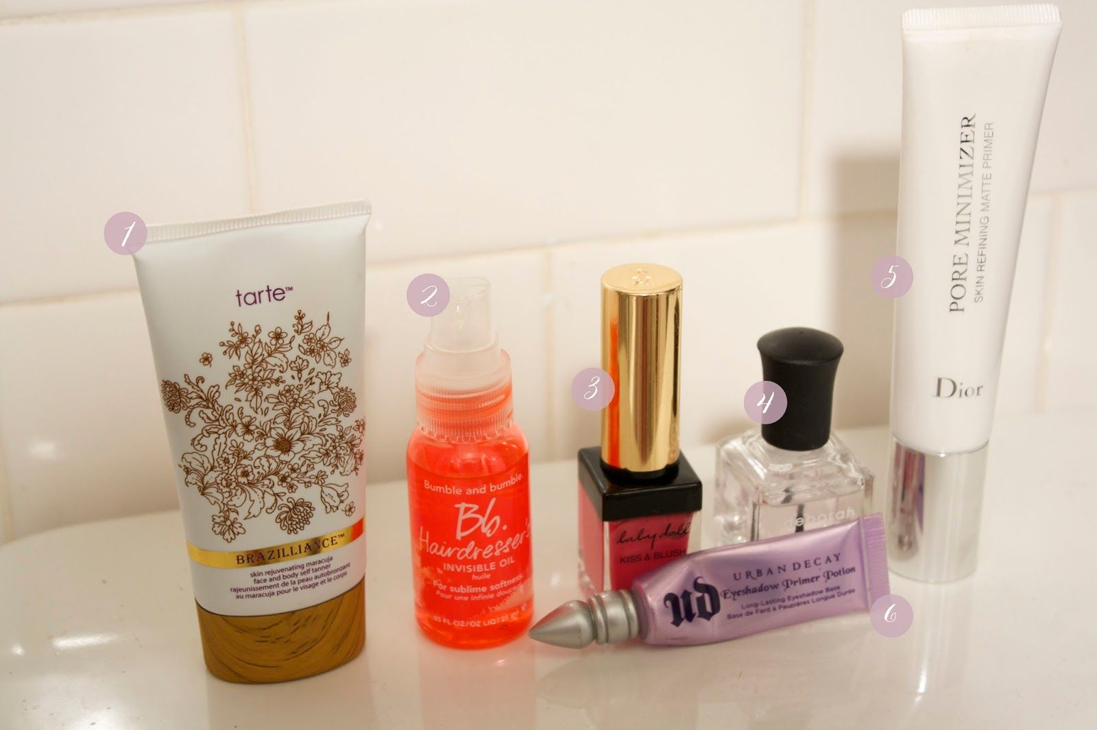 July Beauty Must-Haves; tarte self tanner, bumble and bumble invisible oil, ysl kiss and cheek, deborah lippman top coat, dior pore minimizer, urban decay eyeshadow primer