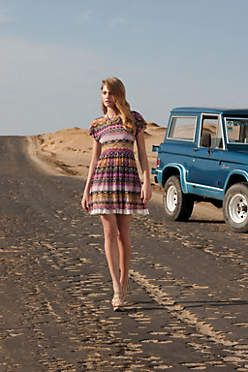 Flared Caraz Dress ~ Anthropologie.  That truck is pretty sweet as well.