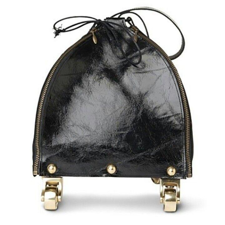 Wheeled drawstring bag by Kei Kagami