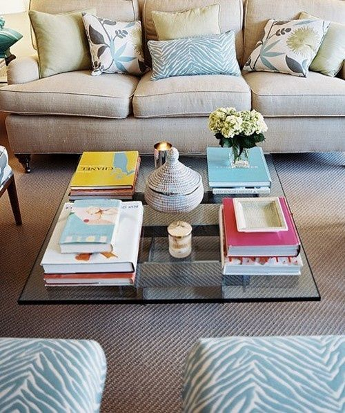 Love the colors in this room. Especially the fabric on the ottomans