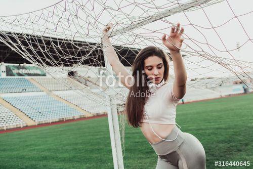 Beautiful fitness woman in sportswear posing near grid. , #affiliate, #woman, #fitness, #Beautiful,...