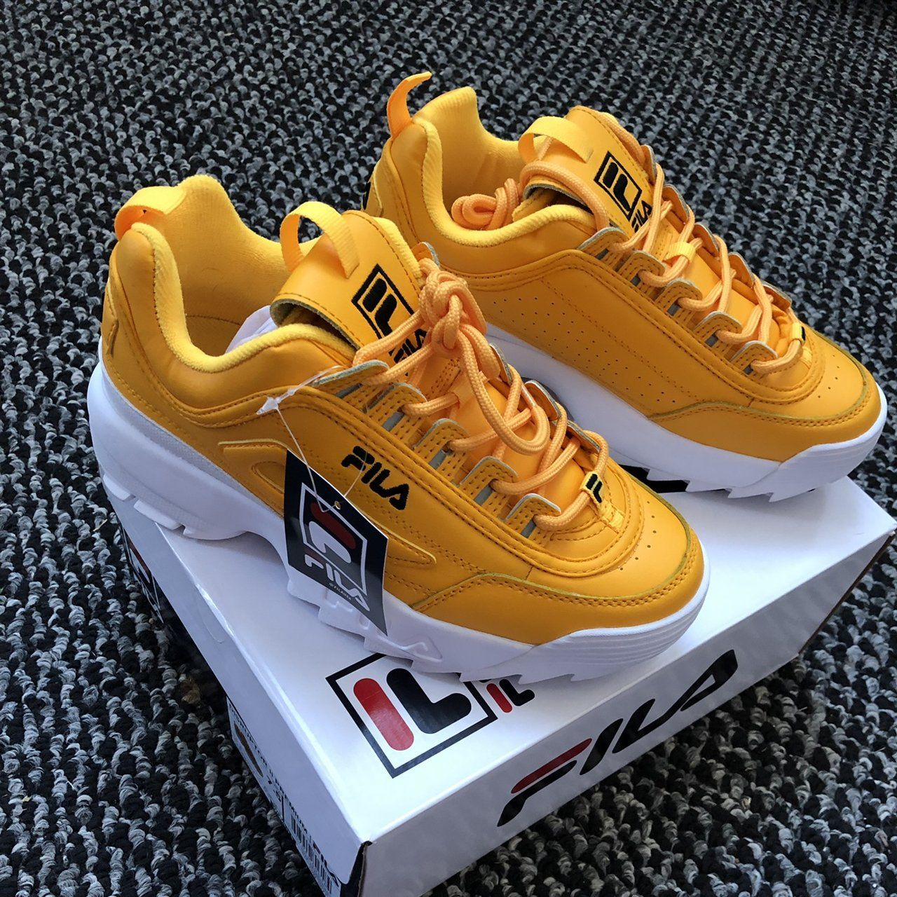 Womens Fila disruptor 2 in yellow. Brand new with tags
