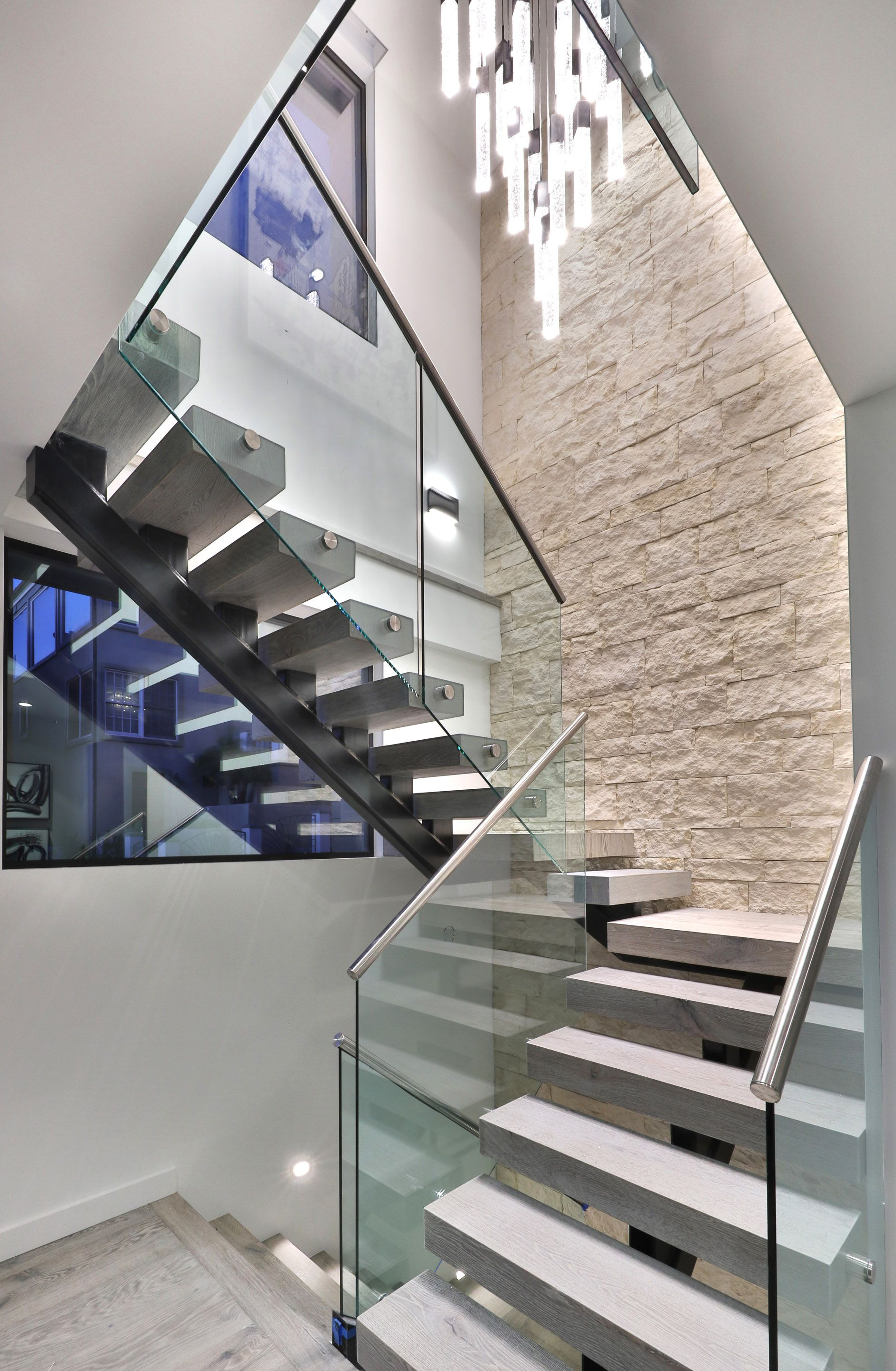 Staircases In Homes Steel Beam Staircase With Chandelier And Stone Wall Digs