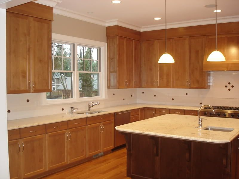 Kitchen soffits wrapped in thin plywood with crown molding ...