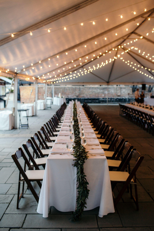 Draped bulbs, white wedding reception tent, white