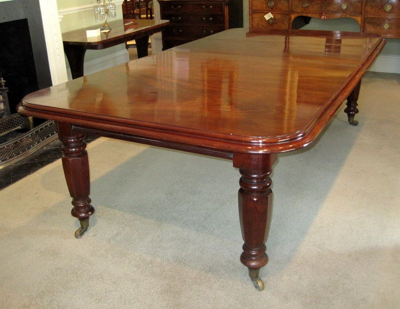 A 19th century mahogany extending dining table with two for Best dining room tables uk