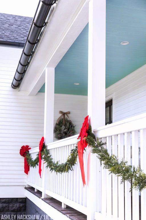 Farmhouse Porch Christmas Decor Ideas - Ashley Hackshaw / Lil Blue Boo -   18 christmas decor outdoor fence ideas