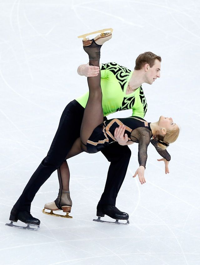Julia Lavrentieva and Yuri Rudyk (UKR) perform in the figure skating team  pairs short program during the Sochi 2014 Olympic Winter Games at Iceberg  Skating ...