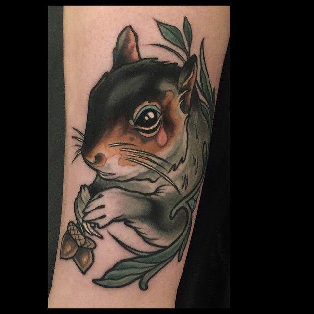 Beautiful squirrel tattoo.