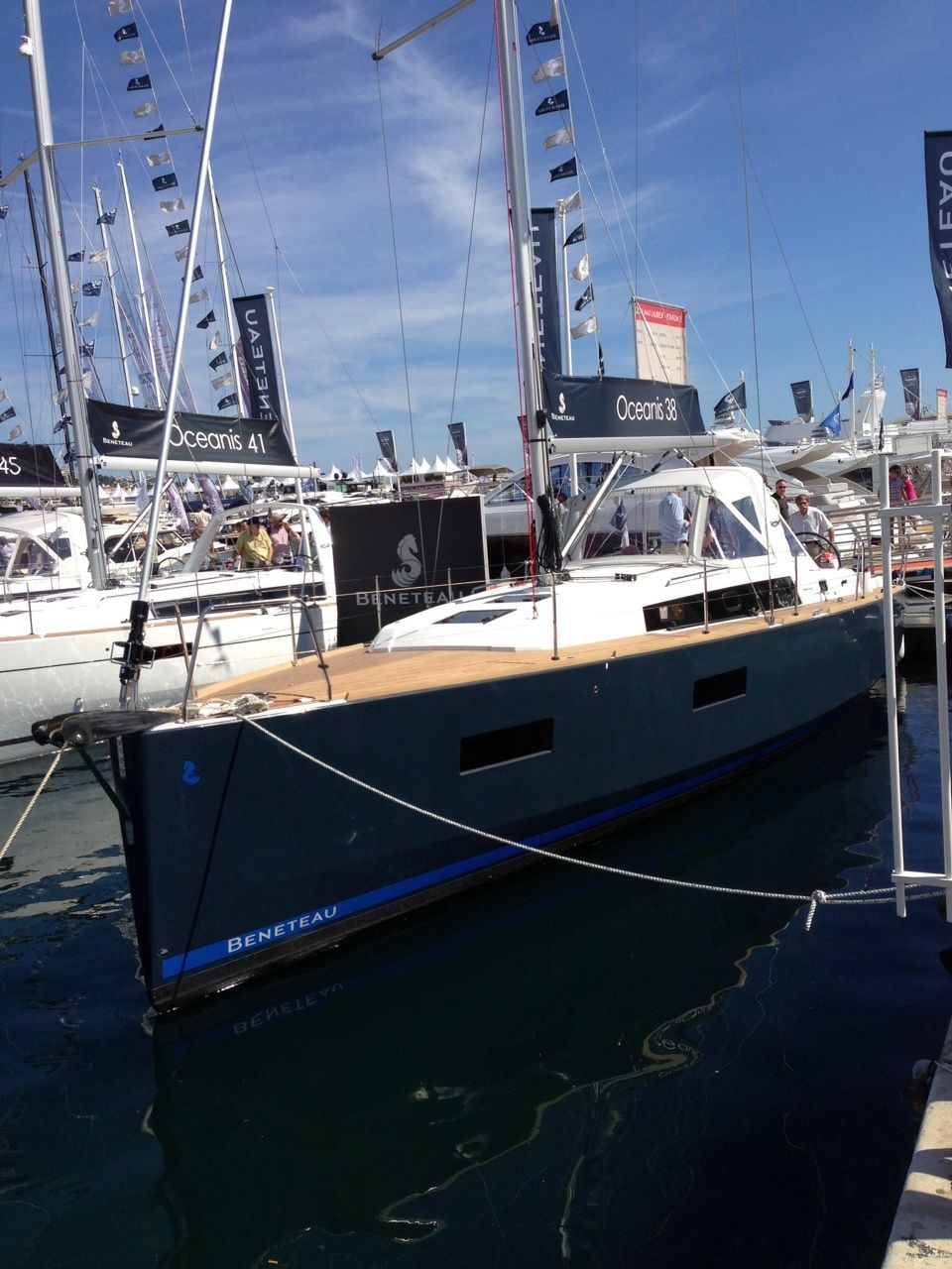 Oceanis 38 with dark hull and teak decks at the Cannes Boat