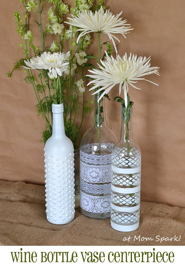 Boho wine bottle vase centerpiece diy floral for Bottle centerpieces